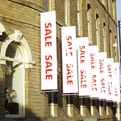 Wall mounted projecting sale banners