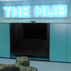 The Hub lit up acrylic letters