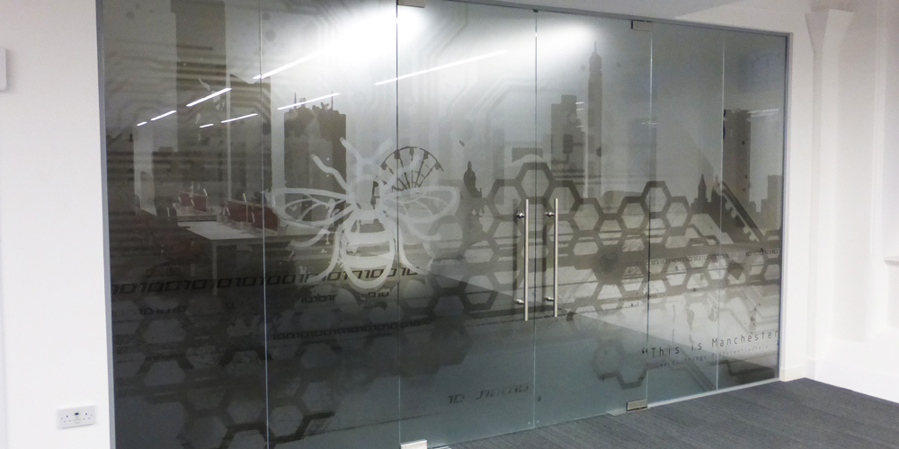 Glass manifestation space3 signage graphics display for Window design company