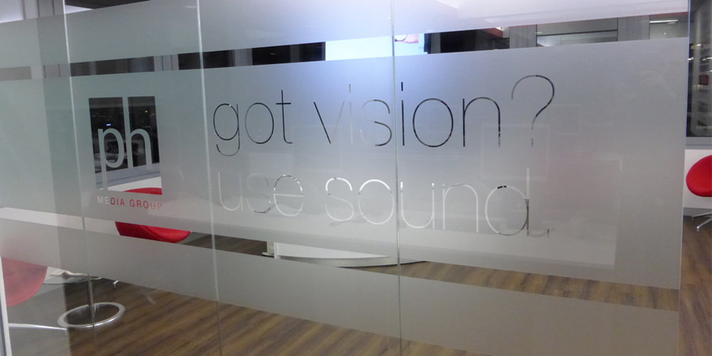Text cut out of glass frost