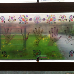Custom window prints with childrens henna hands