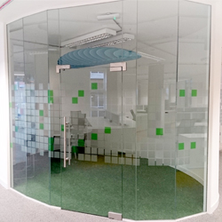 Frosted squares with green squares office glass