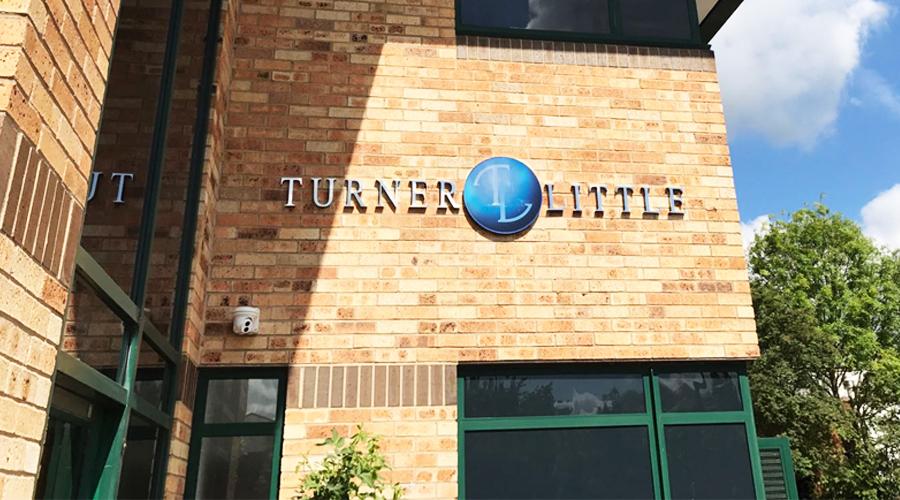 Turner and Little exterior signage - metal